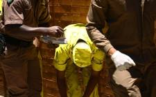 FILE: Warders check a prisoner for contraband and dangerous objects. Picture: Sethembiso Zulu/EWN
