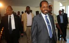 Newly elected Somali president Hasan Sheikh Mahmud arrives at the Jazeera hotel in Mogadishu on September 12, 2012 in Mogadsihu. Somalia's president survived an assassination bid, just two days into his new job, when bomb blasts claimed by Islamist rebels rocked the Mogadishu hotel where he was meeting Kenya's foreign minister. Al-Qaeda linked Shebab insurgents claimed responsibility for Wednesday's attack in which two blasts rocked the hotel where the new president was staying. Picture: AFP.