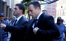 Oscar Pistorius arrive at the High Court in Pretoria ahead of the 20th day of his murder trial on 10 April 2014. Picture: Sebabatso Mosamo/EWN.