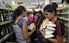 "Venezuelans shop for groceries at a supermarket in Cucuta, Colombia on August 13, 2016. T Venezuela and Colombia on Saturday opened several ""provisional"" border crossing points for pedestrians for the first time in nearly a year as part of a progressive reopening agreed this week. Picture: AFP"