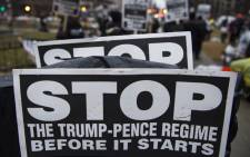 Protesters march during a rally against President-elect Donald Trump in McPherson Square in Washington DC. Picture: AFP.