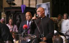 Rev Michael Weeder introduces Pravin Gordhan as the key note speaker at the Ahmed Kathrada memorial in Cape town. Picture: Cindy Archillies/EWN