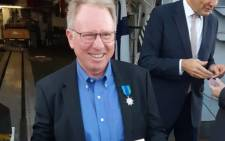 The National Sea Rescue Institute's (NSRI) Craig Lambinon smiles after receiving the Knight in the Order of the Maritime Merit. Picture: nsri.org.za