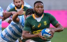 FILE; South Africa's centre Lukhanyo Am runs with the ball during the Rugby Championship international rugby union Test match between South Africa and Argentina at The Nelson Mandela Bay Stadium in Port Elizabeth on 21 August 2021. Picture: Michael Sheehan/AFP