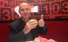 KFC Managing Director Doug Smart gives a thumbs up after taking a bite of a crunch burger at KFC Braamfontein. Picture: Vumani Mkhize/EWN.