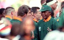 FILE: Nelson Mandela shakes hands with South African team members before the start of the rugby World Cup final at Ellis Park in Johannesburg on 24 June 1995. Picture: AFP.
