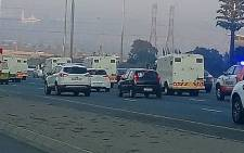 Cash-in-transit vans drive in convoy during their go slow in Johannesburg on 12 June 2018. Picture: @Tlixxy/Twitter via @EWNTraffic