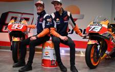 FILE: Repsol Honda Team's Spanish MotoGP rider Marc Marquez and his brother and teammate Alex (R) attend the presentation of the new Repsol Honda team in Madrid on 27 January 2020. Picture: AFP