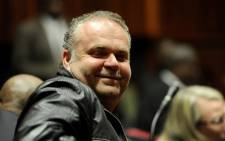 FILE: Czech fugitive, Radovan Krejcir, smiles ahead of his court case at the Johannesburg High Court sitting at Palm Ridge Magistrates Court. Picture: Sapa.