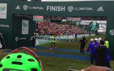 Men's 56km race winner Motlokoa Nkhobotlane crossing the finish line at UCT. Picture: EWN Sport.