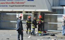 Policemen search after a blast near a school in Brindisi, Italy, on May 19, 2012. Picture: AFP