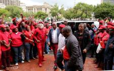 Economic Freedom Fighters members sing outside High Court in Pretoria on 5 March 2014. Picture: Sebabatso Mosamo/EWN.
