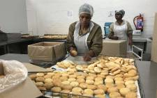 Workers in Dozens Bakery say train delays cause them to arrive late at work.  Picture: Monique Mortlock/EWN
