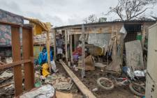 This handout photo taken and received on 15 March, 2015 by UNICEF Pacific shows a resident's home badly damaged by Cyclone Pam, outside the Vanuatu capital of Port Vila. Picture: AFP.