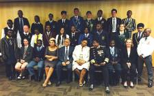 Basic Education officials flanked by the country's top matric learners at the Vodacom Dome on 5 January 2015. Picture: @DBE_SA via Twitter.