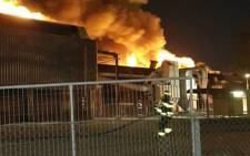 Production has been temporarily suspended after the blaze tore through the factory on 27 October 2015 in Atlantis. Picture: Shawn Gomis/Facebook.