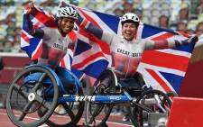 Britain's Hannah Cockroft (R) and her compatriot Kare Adenegan (L) celebrate after the women's 800m (T33) athletics final during the Tokyo 2020 Paralympic Games on 4 September 2021. Picture: AFP