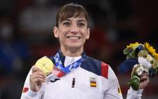 Spain's Sandra Sanchez Jaime poses with her women's kata gold medal in the karate competition of the Tokyo 2020 Olympic Games at the Nippon Budokan in Tokyo on August 5, 2021. Picture: Alexander Nemenov / AFP