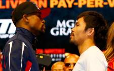 FILE: Floyd Mayweather Jr and Manny Pacquiao face off during their official weigh-in at MGM Grand Garden Arena in Las Vegas, Nevada. Picture: Getty Images AFP.