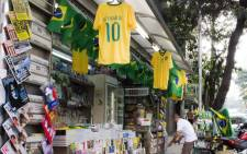 A street vendor on a street in Sao Paulo selling Brazilian soccer shirts and other memorabilia. Picture: Christa Eybers/EWN.