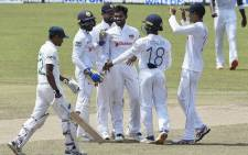 Sri Lanka's Dhananjaya de Silva (C) celebrates with teammates after he dismissed Bangladesh's Taijul Islam (L) during the final day of the second and final Test cricket match between Sri Lanka and Bangladesh at the Pallekele International Cricket Stadium in Kandy on May 3, 2021. Picture: Lakruwan Wanniarachchi / AFP.