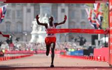 FILE: Kenya's Eliud Kipchoge crosses the finish line to win the elite men's race of the 2018 London Marathon in central London on 22 April 2018. Picture: AFP
