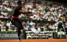 FILE: Serena Williams of the US plays a forehand return to Czech Republic's Kristyna Pliskova during their women's singles first round match on day three of The Roland Garros 2018 French Open tennis tournament in Paris on May 29, 2018.
