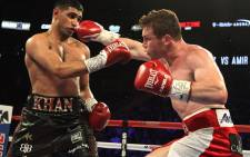 Saul Canelo Alvarez (R) of Mexico throws a right against Amir Khan (L) of Great Britain during their WBC Middleweight Championship fight at the T-Mobile Arena, Saturday, 7 May 2016 in Las Vegas. Picture: AFP.