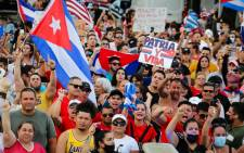 People demonstrate, some holding Cuban and US National flags and placards, during a protest against the Cuban government in Miami on July 11, 2021. Picture: AFP.