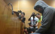 FILE: The 29-year-old truck driver, Amukelani Rikhotso from Giyani in Limpopo, in the dock during his court appearance on charges of negligence. Picture: EWN.