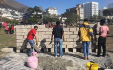 Reclaim the City activists begin building homes in Green Point, Cape Town, on a piece of land they say was promised to them by deputy mayor Ian Nielson. Picture: @ReclaimCT/Twitter.
