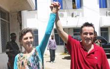 SA couple kidnapped by pirates in the Indian Ocean and held for 18 months, Bruno Pelizzari (R) and Deborah Calitz, outside the presidential palace in Mogadishu on 21 June , 2012, following their rescue. Picture: AFP