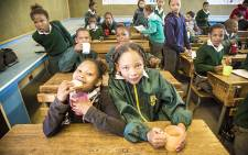 Carnarvon Primary pupils enjoy soup and bread as part of the school feeding scheme's efforts to alleviate pupil's hunger. Picture: Thomas Holder/EWN