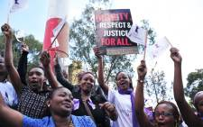 Women chant during a rally in protest against violence towards women on 17 November 2014 in the Kenyan capital Nairobi. Picture: AFP.