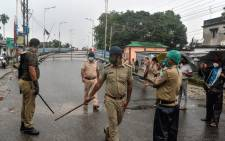 Police personnel patrol on a street shut after a recent lockdown was reimposed in nine wards under Siliguri Municipal area as a preventive measure against the COVID-19 coronavirus in Siliguri on 11 July 2020. Picture: AFP