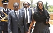 Zimbabwe's President Robert Mugabe arrives to bid farewell to South African former president Nelson Mandela lying in state at the Union Buildings in Pretoria on December 11, 2013. Picture: AFP.