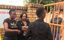 Parents gathered outside the Ninnies Neuron's Nursery School where a teacher was filmed beating children. Picture: Demi Buzo/EWN.