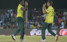FILE: Lungi Ngidi (L) produced a match-winning performance at the death to help the Proteas defeat England by just one run in the first T20 international at Buffalo Park, East London. Credit: AFP