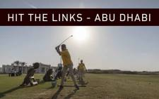 In the late afternoon sun, South African Special Olympics golfers check their swing on the Yas Links in Abu Dhabi. Picture: Thomas Holder/EWN