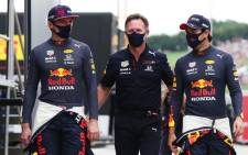 Red Bull's Max Verstappen (left) and Sergio Perez (right) with team principal Christian Horner (centre) at the Hungarian F1 Grand Prix on 1 August 2021. Picture: @redbullracing/Twitter