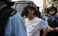 Police detain a young man after fights broke out between pro-China supporters and anti-government protesters at Amoy Plaza in the Kowloon Bay district in Hong Kong on 14 September 2019. Picture: AFP