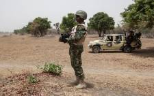 FILE: A Nigerian soldier stands guard near the Yobe river on the outskirt of the town of Damasak in North East Nigeria in April 2017. Picture: AFP.