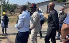 Police Minister Bheki Cele (in black hat) visits the Buhlebethu Primary School in #Inanda on 14 September 2021 where 3 women were shot dead in a drive-by shooting. Picture: @SAPoliceService/Twitter