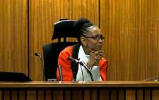 FILE: Judge Thokozile Masipa listens to evidence during the Oscar Pistorius murder trial at the High Court in Pretoria on 9 May 2014.