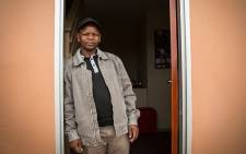 Msindwana Zwelokuphila stands outside his new house as part of the housing project in Langa. Picture: Anthony Molyneaux/EWN.
