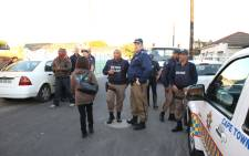 FILE: Metro Police gather in a Elsies River street. Picture: Bertram Malgas/EWN.