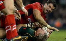 Wales' Mike Phillips (up) tackles South Africa's Jean de Villiers during the International rugby union test match between Wales and South Africa at the Millennium Stadium in Cardiff, south Wales, on November 9, 2013. Picture: AF