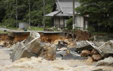 This picture shows a collapsed road due to heavy rain in Higashihiroshima, Hiroshima prefecture on  7 July 2018. Picture: AFP