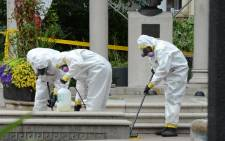 A crime scene clean-up crew scrubs the sidewalks along Danforth Avenue at the scene of the shooting in Toronto, Ontario on 23 July 2018. Toronto police were seeking to determine a motive on after a 29-year-old man opened fire with a handgun on restaurant goers and pedestrians in a busy neighborhood of Canada's largest city overnight, killing two people and wounding 13. Picture: AFP.