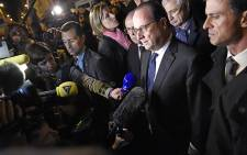 French President Francois Hollande (C), flanked by French Interior Minister Bernard Cazeneuve (Rear C), French Prime Minister Manuel Valls (R) and President of the French National Assembly Claude Bartolone (2nd R), addresses reporters near the Bataclan concert hall in central Paris, early on November 14, 2015. Picture: AFP